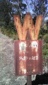 Rusting railway signs on the trail.